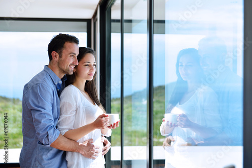 relaxed young couple at home - 69076044