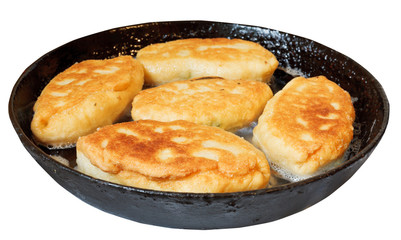 few patties in frying pan isolated on white