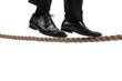businessman walking on tightrope on white background.