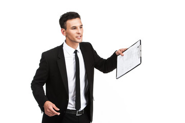 businessman holding clipboard on white background.