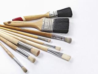 several paintbrushes isolated on white background