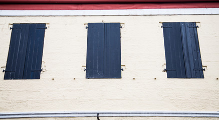 Black Shutters in Stucco Wal