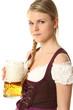 Frau im Dirndl mit Bier