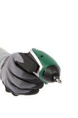 Cordless screwdriver in hand in a protective glove.