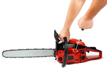 Gasoline chain saw in hand on a white background.