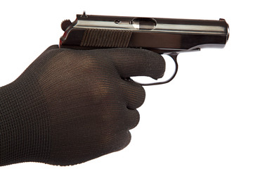 Gun in hand with black gloves.