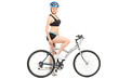 Profile shot of a female cyclist sitting on a bike