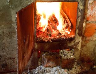hot fire in furnace with open door