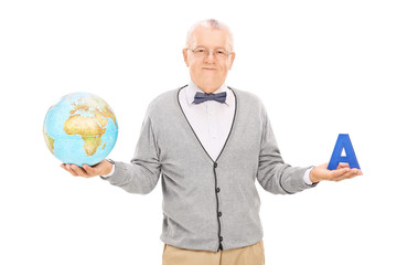 Mature geography teacher holding a globe