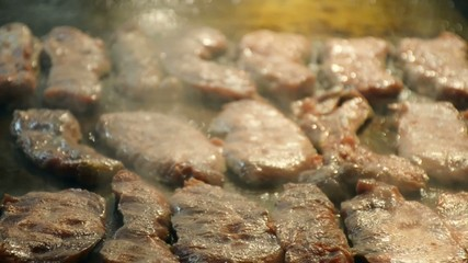 Grilled Beef  steak on hot plate  with smoke
