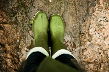 female feet  wearing in gumboots.