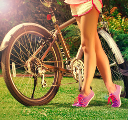 young  girlwith bike in the park