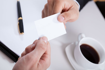 Hands giving business card