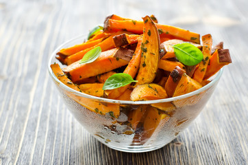 Sweet potato baked in a bowl with herbs