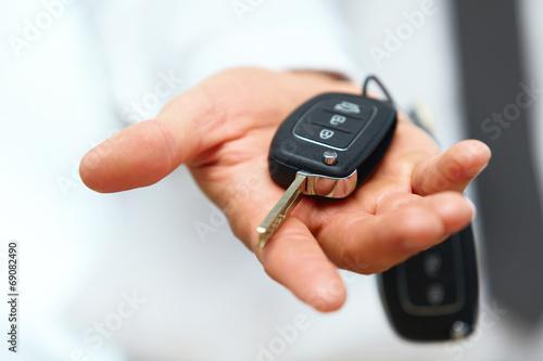 Car Keys. Seller hand giving keys - 69082490