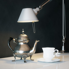 Vintage Metal Coffee Pot With Cup And Lamp On The Coffee Table