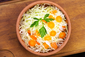 Salad with shredded fresh cabbage and carrot