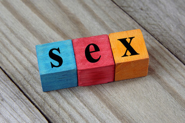 sex word on wooden colorful cubes