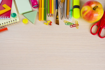 School stationery supplies on table with copy space