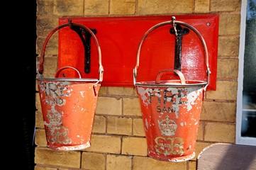 Old Retro Victorian fire sand buckets © Arena Photo UK