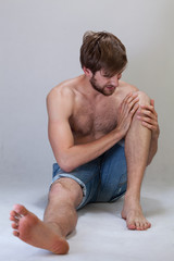 Man with a pain in knee