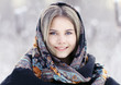 Beautiful Russian woman in a scarf in winter