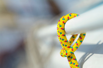 Closeup of yellow thin short rope used for yachting