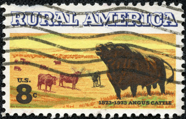 stamp printed in the USA shows Angus and Longhorn Cattle