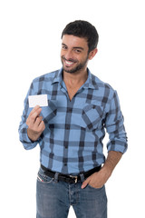 man showing and pointing blank business card smiling happy