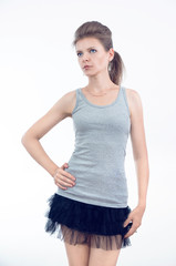 Girl dressed in gray casual t-shirt and skirt, front view,