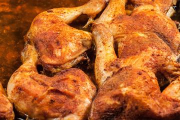 Fried chicken legs in deep fat. Selective focus.