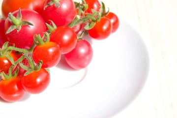 Colourful tomatoes on a white plate