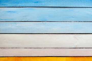 Yellow blue white wooden wall
