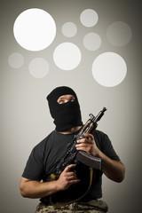 Man with gun. Gray bubbles.