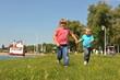 children running on the grass