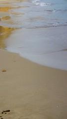 Strand mit Wellen vid 50