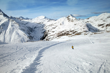 The man skiing on snowy slope in Alps, Sportgastein