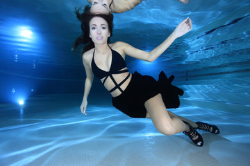 Young woman underwater in the pool