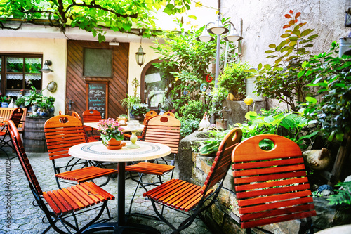 Cafe terrace in small European city - 69091829