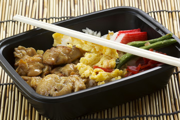 Chicken Toriyaki rice in plastic box with chopsticks