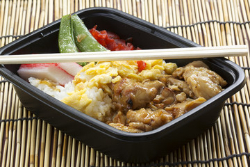 Chicken Toriyaki rice in plastic box with chopsticks