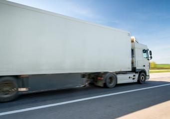 Truck on road, motion blur