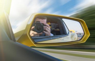 Photographer in a car