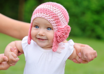 beautiful baby girl with hat smiling