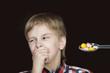 Boy refusing to take medicine on a spoon