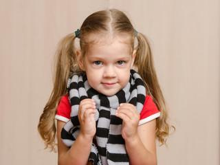 The three-year girl in a diseased warm scarf