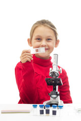 little girl holding a glass slide for the microscope