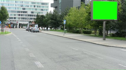 billboard in the city,road and buildings - green screen - cars