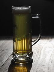 beer on wooden table backlit