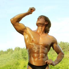 bodybuilder squeezes out orange juice